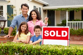 Roca Real Estate Family with Sold Sign